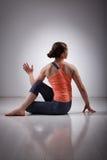 Sporty fit yogini woman practices yoga asana Stock Photos