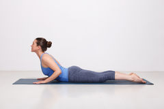 Sporty fit yogini woman practices yoga asana Stock Images