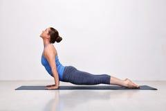Sporty fit yogini woman practices yoga asana Royalty Free Stock Photo
