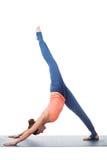 Sporty fit yogini woman practices yoga asana eka Stock Image
