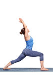Sporty fit yogini woman practices yoga asana utthita Virabhadras stock image