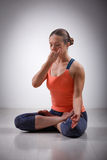 Sporty fit yogini woman practices yoga pranayama Stock Photography