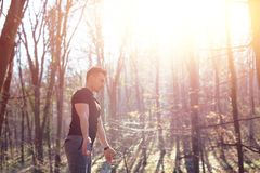 Sporty fitness man rising arms. In nature stock image