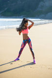 Sporty fitness woman exercising at the beach Stock Photo