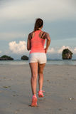 Sporty fitness woman running at the beach Stock Photos