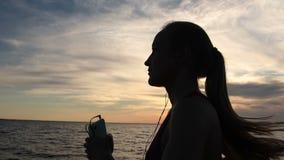Sporty fitness woman running on seaside at sundown stock video footage
