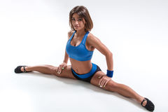 Sporty flexible girl doing stretching exercise Stock Photo