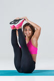 Sporty flexible girl doing stretching exercise Stock Images