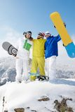 Sporty friends. Portrait of three sportsmen standing on the mountain Royalty Free Stock Photography