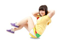 Sporty girl. Young girl exercising. isolated on the white background Stock Photography
