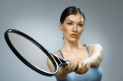 Sporty girl. Beautiful sporty girl playing tennis very passionately Royalty Free Stock Photos