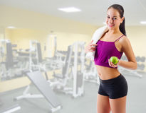 Sporty girl with apple at gym club Royalty Free Stock Photography