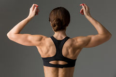 Sporty girl back with muscles Royalty Free Stock Images