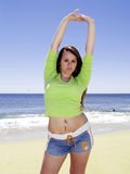 Sporty girl at beach Royalty Free Stock Photography