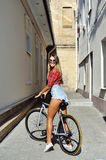 Sporty girl on a bicycle outdoor.  Royalty Free Stock Photography