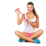 Sporty girl checking breast measurement Royalty Free Stock Images