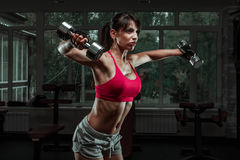 Sporty girl doing exercise with dumbbells Stock Photo