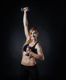 Sporty girl doing exercise with dumbbells. Sport picture with fitness woman on it doing exercise with dumbbells Royalty Free Stock Image