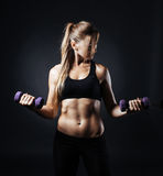 Sporty girl doing exercise with dumbbells. Sport picture with fitness woman on it doing exercise with dumbbells Stock Photos