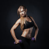 Sporty girl doing exercise with dumbbells. Sport picture with fitness woman on it doing exercise with dumbbells Stock Image