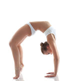 Sporty girl doing gymnastic bridge in studio Stock Photos