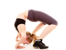 Sporty girl doing stretching exercise isolated Royalty Free Stock Image