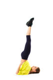 Sporty girl doing stretching exercises. position on the head upside down Royalty Free Stock Photos