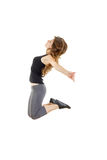 Sporty girl doing stretching exercises. slim hip-hop style teenage dancer dancing royalty free stock images