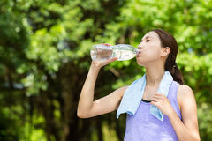 Sporty girl drink water after running Royalty Free Stock Photography