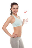 Sporty girl drinking water from a bottle after a workout, fitness training, isolated on white background Stock Image