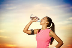Sporty girl  drinking water Stock Photography