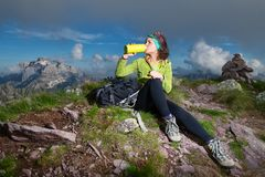 A sporty girl drinks from the water bottle after having conquere Stock Photos