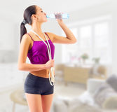 Sporty girl drinks water Royalty Free Stock Photo
