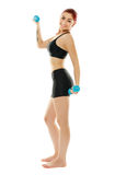 Sporty girl with dumbbells Royalty Free Stock Photos
