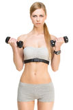 Sporty girl with dumbbells Stock Images