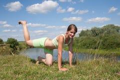Sporty girl exercising Stock Photos