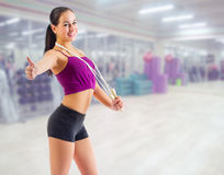 Sporty girl at fitness club Royalty Free Stock Image