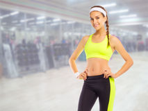 Sporty girl in fitness club Royalty Free Stock Photo