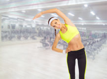 Sporty girl in fitness club Royalty Free Stock Photography