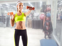 Sporty girl in fitness club Stock Images