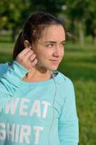Sporty girl fixing earphone Stock Photo