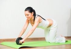 Sporty girl in gym Stock Photos