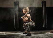 Sporty girl on gym. Sporty girl training on gym ith some sports equipment Royalty Free Stock Photo
