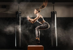 Sporty girl on gym. Sporty girl training on gym ith some sports equipment Stock Photos