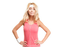 Sporty girl in headphones on white background. Stock Photography
