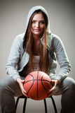 Sporty girl holding basketball Royalty Free Stock Photography