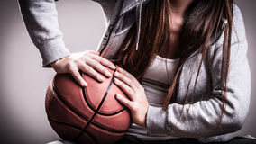 Sporty girl holding basketball Stock Photography