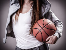 Sporty girl holding basketball Royalty Free Stock Images