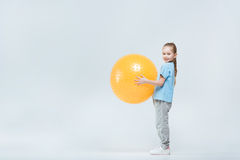 Sporty girl holding fitness ball on white. Smiling sporty girl holding fitness ball on white Royalty Free Stock Photography