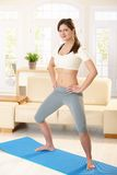 Sporty girl at home Stock Photo